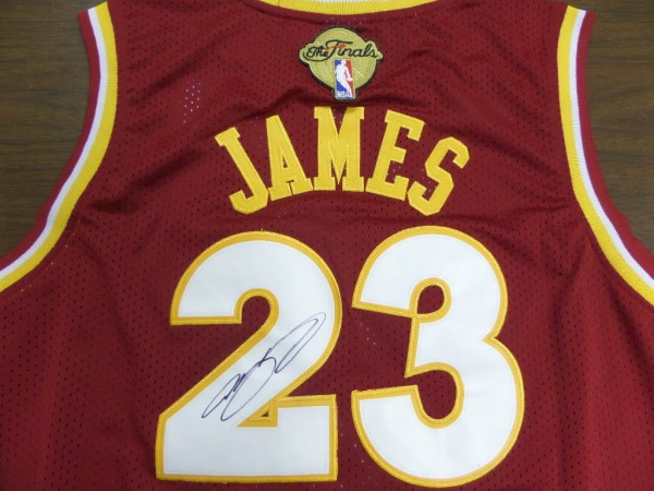 This mint road maroon is trimmed in white and gold team colors, has sewn on everything as well as name on back, and comes tagged right by the NBA store. It is a must have, solid future NBA HOF investment in maybe the best ever, and comes back #23 signed in bold black sharpie. It is a clean 9+ all day long, value can reach thousands online, and of course we can fully, no-nonsense lifetime guarantee it.