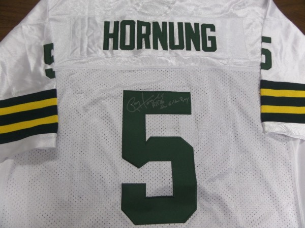 This mint 1966 style Green Bay home white comes trimmed in gold and white team colors and features sewn on everything as well as name on back. Great look from the aging fast HOF runner and former Notre Dame Heisman winner, and IN PERSON, back #5 signed in silver sharpie. He has included his #5 HOF 86 and the Golden Boy!! Wow.