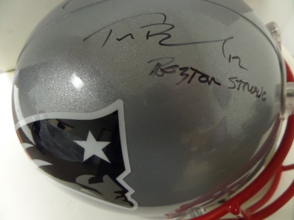 This mint Riddell Pats full-sized helmet comes signed superbly by this future HOFer in black sharpie with his #12 and Boston Strong included by Tom Terrific!  Rare inscription and retail is into the low thousands. NICE!!