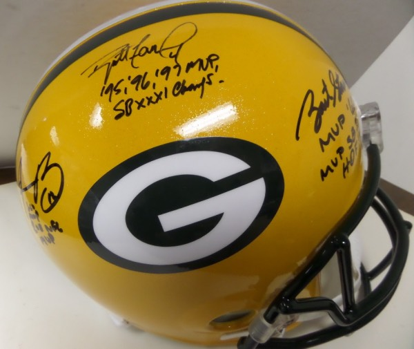 This mint, full-sized Riddell Packers helmet comes hand signed by three of the all-time NFL greats QB's that all starred for the Packers . Brett Favre, Aaron Rodgers and Bart Starr have all signed in bold black sharpie, all on the same side for EZ show off, and added AMAZING stats and their numbers!!  Value is low thousands on this prized Green Bay HOF investment helmet.  NICE!!