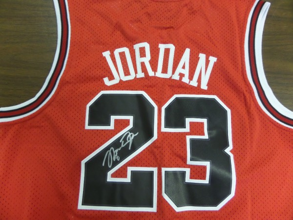 Wow, this authentic Nike jersey is red with black numbers and white trim and mint! It has been signed perfectly on the back #23 by this legend in silver.  Perfect for display and retails well into the low thousands from the best ever.
