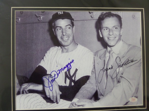 This 11x14 professionally-matted display features a black and white photo of 20th Century Icons Joe DiMaggio and Frank Sinatra, sitting in a locker room after a New York Yankees game.  It is hand-signed by both boldly in sharpie, and with both now long deceased, retail is well into the hundreds!