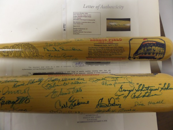 This fabulous collector's item is a commemorative Cooperstown Bat Co. bat, hand-signed all over the barrel in blue sharpie by 35 members of Brooklyn Dodgers teams from the early '40's to the team's final season in Brooklyn in 1957.  Included are HOF'ers Duke Snider, Pee Wee Reese, Billy Herman and Dick Williams, as well as notables like Cal Abrams, Andy Pafko, Ralph Branca, Carl Erskine, Al Gonfriddo, Clem Laine, Billy Loes, Mickey Owen, Joe Pignatano, Johnny Podres, George Shuba, Rube Walker and more.  A full photo LOA is provided by JSA (Y16069) for authenticity purposes, and retail here is low thousands!