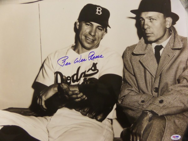 This large black and white photo is an image of Brooklyn Dodgers captain Pee Wee Reese, and comes hand signed in blue sharpie by the HOF shortstop himself.  This is a fine looking, bold signature, grading a 9-9.5 at least, and it comes certified by PSA/DNA (C31459) for authenticity purposes.  With Reese's death now nearly 20 years ago, retail here is well into the hundreds!