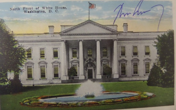This full color vintage postcard of The White House is in NM condition, and comes blue ink-signed by 35th United States President, John F. Kennedy!  The signature resides on an excellent viewing spot, grades a solid, legible 7.5, and with his assassination now more than a half century ago, retail here is easily well into the thousands on this historic item of Americana!