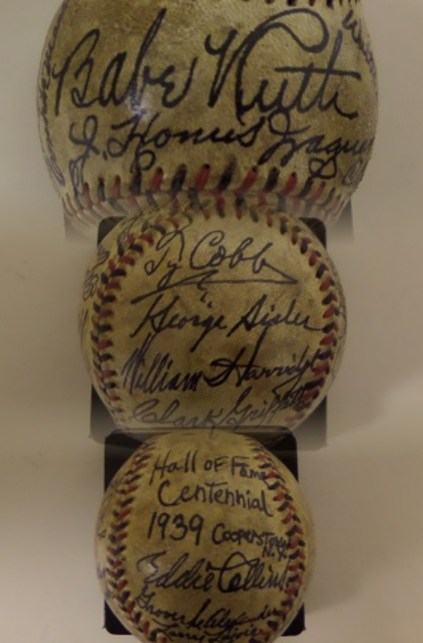This vintage red and black-laced baseball is cubed in VG condition overall, and comes hand-signed all over by 15 participants of the 1939 Hall Of Fame Opening ceremonies!  Included are Babe Ruth & Honus Wagner on the sweet spot, Walter Johnson and Cy Young on the right panel, Ford Frick, Kennesaw Mountain Landis, Tris Speaker and Connie Mack on the left panel, and Ty Cobb, Clark Griffith, George Sisler and William Harridge on the bottom panel.  The ball has obviously been protected well over the years, and most signatures grade 6's-8's here.  Comes with a full LOA from Barry Halper, and retail is five figures, easily!