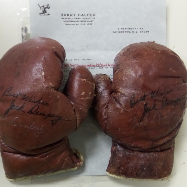 "This rare lot is a pair of small (maybe 4 ounce) of vintage red Everlast boxing gloves that are Jack's own signature model. They are well worn and in F shape overall but each comes signed GORGEOUSLY by this deceased boxing HOFer in black with ""Best Wishes"" included on each!  Comes with a signed COA from Barry Halper on his own letterhead and high retail value."