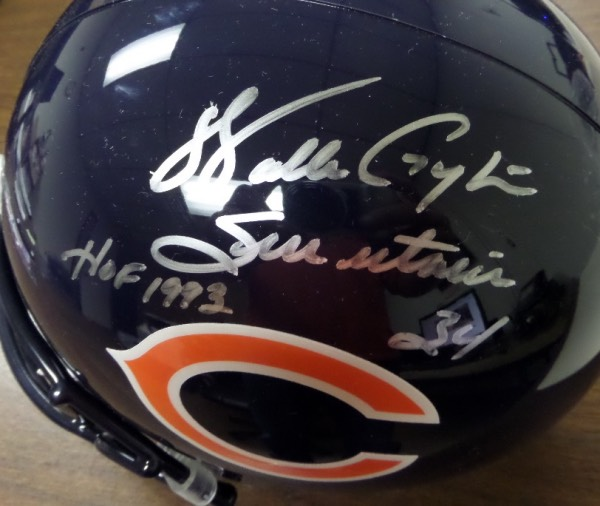 This full size Chicago Bears football helmet from Riddell is boxed in NM condition, and comes hand-signed in silver by former All Time Rushing King, Walter Payton.  The signature grades a legible 8 at least, and includes Sweetness, 34 and HOF 1993 inscriptions.  With his death now just short of 20 years ago, retail is easily high hundreds on this baby!