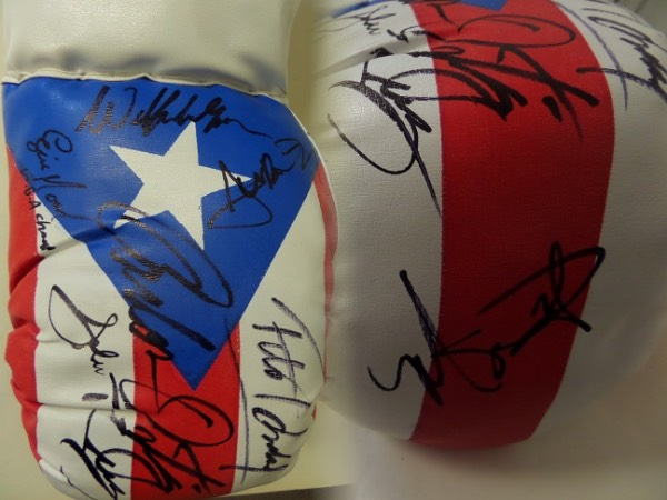 This mint 16 oz. glove has the Puerto Rican flag on it and comes signed wonderfully in black by 7 legends from the island!  INcluded are big names like Felix Tito Trinidad, Miguel Cotto, Wilfredo Gomez, Carlos Ortiz, John Ruiz, Juan Manuel Lopez, & Eric Morel! A must for the boxing fan from PR and retails in the upper hundreds easily.
