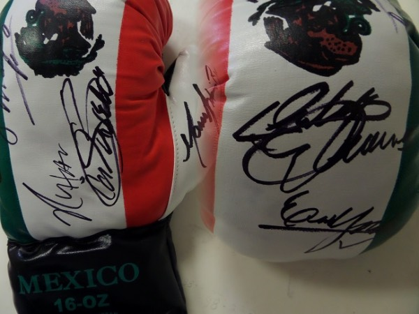 This mint 16 ounce boxing glove has laces and the Mexican flag on it and is GORGEOUS. It comes signed by 7 of the best legends of the ring that hailed from Mexico in black and included are big names from the past and present.  I see Julio Cesar Chavez Sr., Marco Antonio Barrera, Erik Morales ,Canelo Alvarez, Ricardo Lopez, Juan Manuel Marquez, & Ruben Oliveras!! Amazing offering for the Mexican boxing collector!