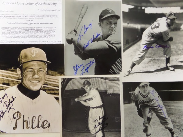"This one of a kind Phillies opportunity is TWENTY-THREE different black and white photos, almost all 8x10's, with many vintage, and some wire photos, each hand-signed by a different member of the 1950 NL Champion ""Whiz Kids"" Phillies.  Included are Del Ennis, Stan Lopata, Granny Hamner, Whitman, Ridzik, Silvestri, Heinzelman, Church, Caballero and Blatnik!  Awesome lot here, a one time only chance for a real gem to add to any Phils collection, and comes with a copy of the original Huggins & Scott Auction JSA group LOA for authenticity, but really, all you really need to do is look at these beautiful photos to know they're genuine!"