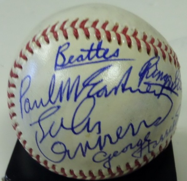 This amazing collector's item is a dream come true for fans of the Fab Four!  It is an Official National League Baseball from Rawlings, Giles, President, and hand-signed in blue ink by all four Beatles!  All four signatures reside on the same panel, ideal for display, and all grade 7's or better, with one of them adding the Beatles as an inscription (looks to have been McCartney).  Comes fully certified by court-qualified forensic science expert Chris Morales, and book value here is thousands upon thousands!!!