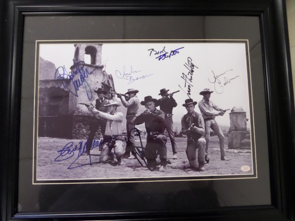 This 1960 movie image is large and comes to you cusom double matted and wood framed, and measures a suoper big 18x24 in size. It shows, well, all 7 magnificent stars in action and at a gun fight, and comes hand signed by everyone. All 7 are now deceased, a lifetime LOA from Iconic Legends accompanies, and stars include James Coburn, James Garner, Steve McQueen, Yul Brynner, Charles Bronson and more. High value, classic Hollywood movie, and value is about $1800.00. on the impossible to find beauty.