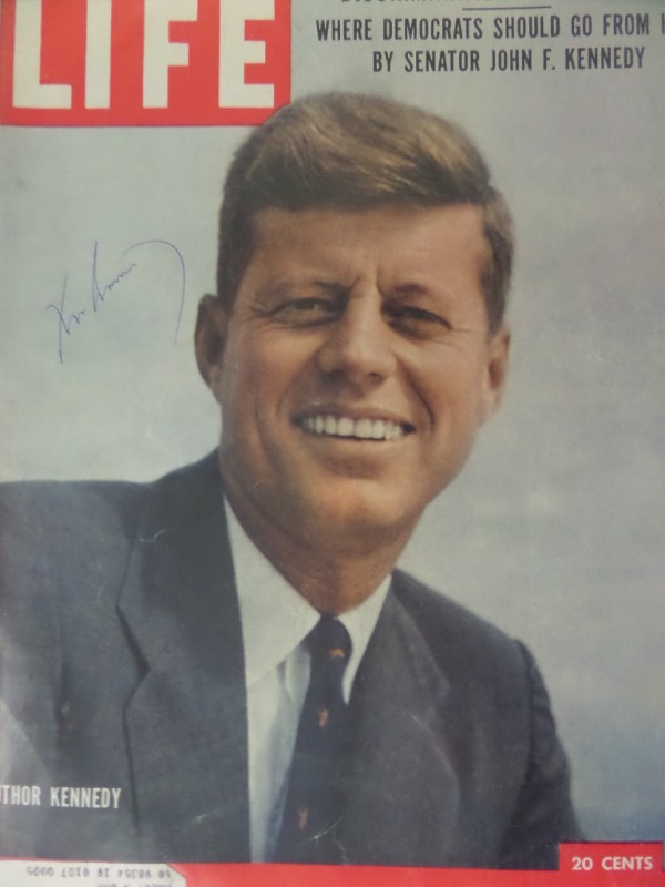This March 11, 1957 full issue of LIFE magazine shows a full color image of JFK on the front cover, and comes hand-signed in blue ink by the man himself.  The signature sits on a nice bright viewing spot, grading an overall 7.5-8, and with the President's death now 55 years ago, retail is well into the thousands!