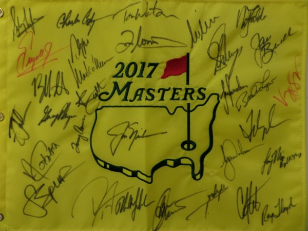 This MINT yellow 2017 Masters pin flag is a real looker and comes hand-signed in red and black sharpie by 30 different champions of the famed Augusta National major tournament.  Included are Nicklaus, Woods, Singh, Langer, Faldo, Weir, Watson, O'Meara, Zoeller, Player, Cabrera, Spieth, Mickelson, and many more.  An ideal addition to any clubhouse or collection, and retail is easily low thousands on this baby!