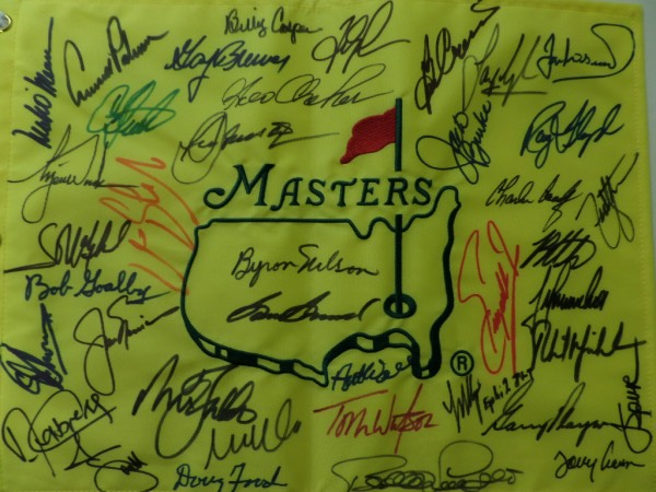 This $5000.00 pin flag is a custom made, fully embroidered piece from Augusta, and about 18x20 in size. It comes sharpie signed by MANY, winners like Watson, Nicklaus, Player, Palmer, Tiger, Zoeller, Floyd, Snead, Casper, Mickleson, Nelson and more are present, and grade is a bold 9 or better! It is just an incredible, course obtained piece from our regular consigner, and ok'd by Lee for certainty.