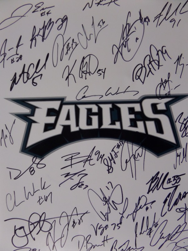 This 11x14 Philadelphia Eagles team logo print is hand-signed in black sharpie by more than 35 members of the defending Super Bowl Champs!  Included are Wentz, Foles, Cox, Long, Blount, Barnett, Smith, Graham, Ertz, Jeffrey, Agholor, Jenkins, and all of the other big names, and the piece is an ideal size for framing and display.  Commemorate this years improbable Championship run with this gorgeous piece!