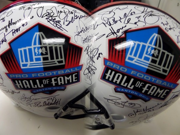 This full size Pro Football Hall Of Fame logo replica helmet from Riddell is a real looker that is hand-signed in black sharpie by more than 50 greats of the gridiron!  Included are Elway, Swann, Houston, Biletnikoff, Kelly, Gifford, Smith, Namath, Bradshaw, Young, Aikman, Brown, Staubach, Long, Bettis, Hannah, Butkus, Favre, Ditka, Riggins, Irvin, Montana, Sayers, Taylor and so many more.  Valued well into the thousands!
