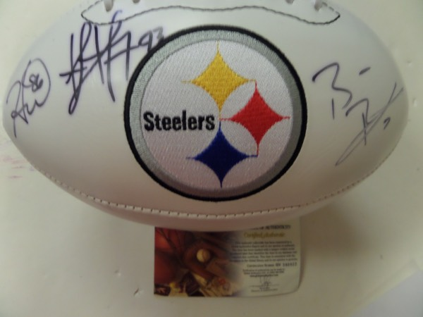 This full size, triple white panel Pittsburgh Steelers commemorative white panel football features an embroidered team logo and championship information.  It is hand-signed by three key members of the modern Super Bowl Champion Steelers team, including Ben Roethlisberger, Hines Ward and Troy Polamalu, and comes certified by Global Authentics (GV590922) to boot!  With all three destined for Canton, the retail value here is easily high hundreds!