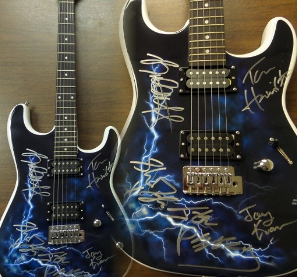 This gorgeous mint electric guitar is white with a gorgeous blue and black lightning style body and it has been signed in silver wonderfully by STEVEN TYLER, JOE PERRY, BRAD WHITFORD, TOM HAMILTON, & JOEY KRAMER!!  Perfect for display and retails into  the low thousands.  WOW