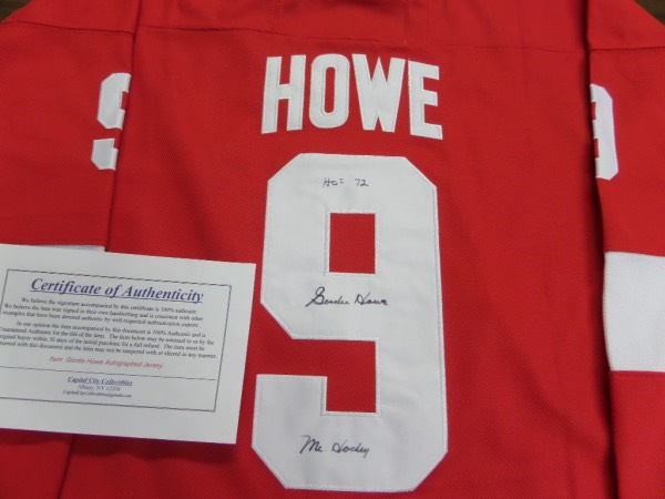 "This mint Detroit road red is trimmed in basic white and has sewn on everything as well as name on back. It comes back #9 signed by ""Mr.Hockey"" who has added that moniker, as well as ""HOF 72"" and value is upper hundreds since his death, and with the included Capitol City lifetime LOA."