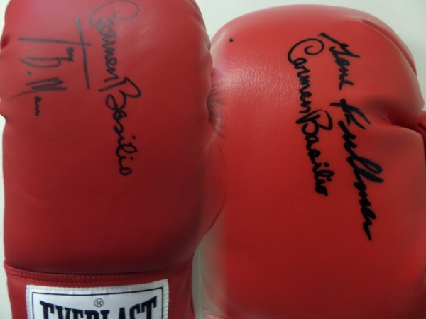 This fantastic boxing collector's chance is TWO red lace up Everlast boxing gloves, each hand-signed by two different great champions.  One is autographed by former Welterweight crown holders, Carmen Basilio and Tony DeMarco, and the other by former Middleweight champs, Basilio and Gene Fullmer, and the gloves come with a copy of the original Huggins & Scott JSA group LOA, which lists each glove specifically.  With only DeMarco still living, the retail here is well into the hundreds!