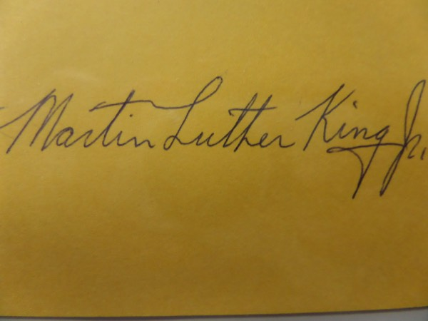 This bright yellow cut of paper looks to have been taken from an original collector's album.  It is in NM condition, measures about 2.75x4.25, and comes black ink-signed by Civil Rights legend, Martin Luther King, Jr.  The signature grades a legible 7, and the piece is ideal for matting, framing and display.  Valued well into the hundreds from this American icon, deceased now 50 years!
