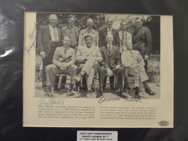 This 1939 B&W image shows all 10 original Inductees and comes ink signed by 7 of them. I see signatures from Lajoie, Honus Wagner, Speaker, Mack, Ty Cobb, Cy Young and George Sisler appearing, and a custom black mat surrounds it. It grades a clean sharp 8 or better, value just in signatures is thousands, and show off is easy from 20 feet away. Add in an Authentic Collectibles LOA and you have a solid Cooperstown buy and hold investment.