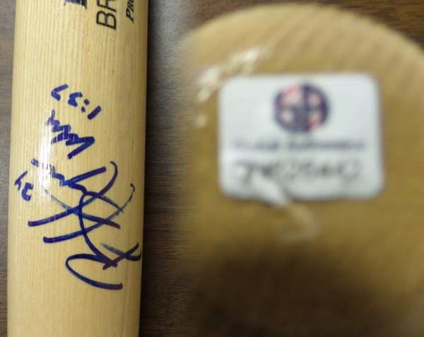 This blonde Bryce Harper model Adirondack Pro Big Stick Rawlings baseball bat is in NM/MT condition, and comes hand-signed on the barrel in blue sharpie by one of the game's very best, Washington Nationals All Star outfielder Bryce Harper.  The signature is a strong, overall 9, and the knob of the bat is affixed with a sticker (No COA included) from Global Authentics (GV 626442).  Valued into the high hundreds!
