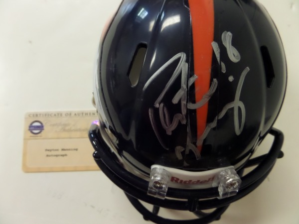 This Denver Broncos mini Riddell football helmet is boxed in NM/MT condition, and comes hand-signed in silver by future HOF quarterback, Peyton Manning.  Signature is about a 7 here, and the pieces is accompanied by a COA and hologram from none other than Steiner Sports Memorabilia for absolute authenticity!  Valued well into the hundreds!