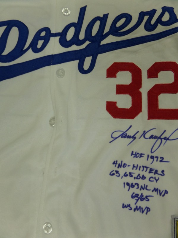 This mint LA home white is trimmed in red and blue team coiors and has sewn on everything. It is a 1958 throwback style from the Cooperstown Collection, comes blue sharpie signed, and with a ton of cool career stats written by Koufax himself. It is an IN PERSON, paid for and obtained piece, value is 2 grand as he is very reclusive and tough, and Lee himself guarantees authenticity. It is a 10 in every sense of the word, sold here with NO reserve, and a valuable piece of both LA and Brooklyn baseball history.