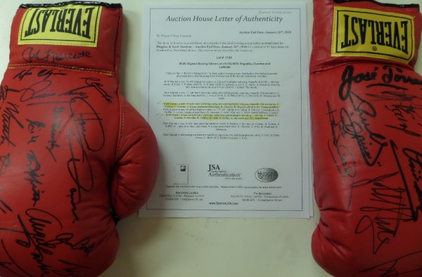 This MUST HAVE boxing fan's dream come true is TWO red lace up Everlast gloves, hand signed by a grand total of 25 all time greats of the ring.  Included in the signatures are names like Alexis Arguello, Gerry Cooney, Pipino Cuevas, Bert Sugar, Jose Torres, Iran Barkley, Angelo Dundee, Emile Griffith, Ruben Olivares, Carlos Ortiz, and many more, and the gloves come with respective copies of the original JSA group LOA--even highlighted, please see picture!  With so many of these ring legends deceased, retail is hundreds for each.  Both together?  WOW!!!