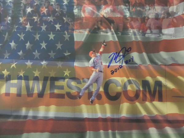 "This 18x24 full sized color gem shows Trout in action, making a diving catch against the wall, and with rhe American Flag as the background. Solid piece, blue sharpie signed with ""2012 ROY"" written as a bonus in his hand, and valued at $1400.00 or so. Lee puts his own name on for certainty, it sells at or above this opening bid price, and it is a solid future Cooperstown buy and hold investment as well."