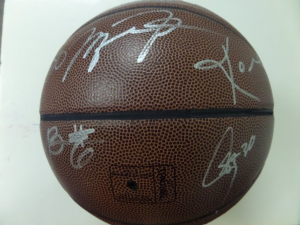 This future HOF worthy ball is mint, full-sized, all leather, and stamped by Spalding. It comes hand signed by 5 current superstars in silver, all 5 are future HOF candidates, and all 5 have signed on 2 panels close to one another. Names include Jordan, LeBron, Steph Curry, Kevin Durant and Kobe Bryant. Solid showpiece, super hi-value, and held together by an included Capitol City lifetime LOA.-Wow!!!