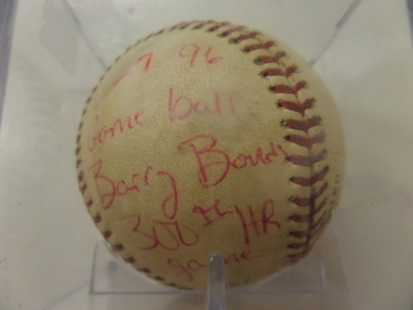 This ball comes right out of Barry's Collection and shows lots of game uage and pre-game rub. It is an Official NL ball, hit by Barry for his 300th Big League HR, then signed in red ink on a side panel. It comes dated and noted in his hand, it is a super rare, super cool future HOF investment ball, showpiece and conversation item, and may one day even be lent to Cooperstown. It can only go up in value!