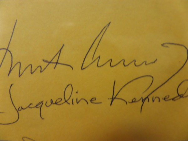 "This vintage cut of yellow paper measures approximately 2.25x4.25"" in size, and comes autographed in black ink by America's beloved 1960's ""First Couple"", John and Jacqueline Kennedy.  The signatures each grade 8's or better, and with JFK's tragic murder now more than 50 years ago, and Jackie's untimely death now more than 20 years ago, this piece is valued into the low thousands!!!!"