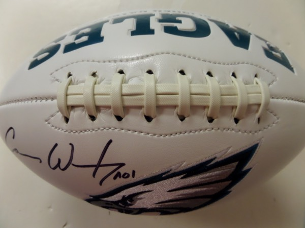 This full size, triple white panel football features an embroidered team logo and championship info.  It is hand-signed in bold black sharpie by the man who was the frontrunner for the NFL MVP award before his injury, Carson Wentz, and is a seriously high valued item in the Philly market right now!