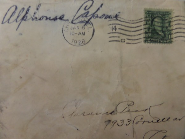 This roughly 4x5 vintage envelope is affixed with a 1cent stamp, and is stamped from January of 1928 ... NINETY YEARS AGO!!!  It is hand-signed in black fountain pen ink on the upper left hand corner by the famed prohibition crime boss himself, grading about a 6.5 and comes certified by forensic science expert Chris Morales for authenticity!  Valued well into the low thousands, but we'll start the bidding low!