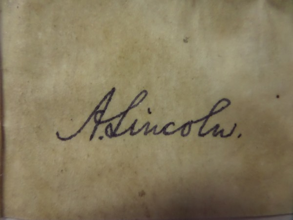 This 150+ year old cut is from an original document or letter of some sort, slightly stained and in EX condition, AND is hand-signed in black ink by the long-deceased US President.  The signature grades a legible 5.5 overall, and the piece is perfect for matting and framing with the photo or $5.00 bill of your choice, measuring a very workable 2.5x3.75 in size.  Valued well, WELL into the thousands!  By the way, check out the John Wilkes Booth cut on this very same page, and make a TRULY unique display!