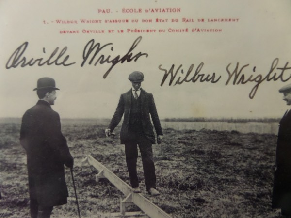 This vintage black and white French photo postcard shows an image of The Wright Brothers planning the logistics of their airplane, and comes hand-signed in black fountain pen by both!  Included are Orville and Wilbur, each grading a bold 8+, and with both innovators long-deceased, retail on this baby is easily low thousands!