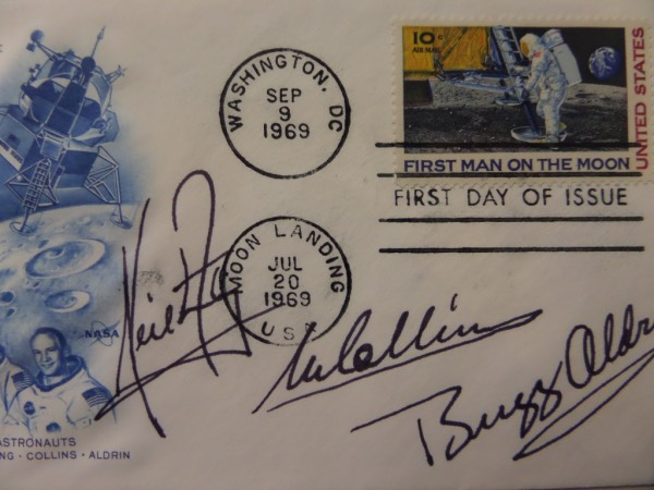 "This July 20, 1969 AND September 9, 1969 double stamped ""Man's First Landing On The Moon"" First Day Of Issue cachet is affixed with a First Man On The Moon stamp, and comes hand-signed in black by ALL THREE Apollo 11 moon landing astronauts.  Included are Michael Collins, Buzz Aldrin and Neil Armstrong, with each signature grading an 8+, and retail on this small but powerful piece is high hundreds!"