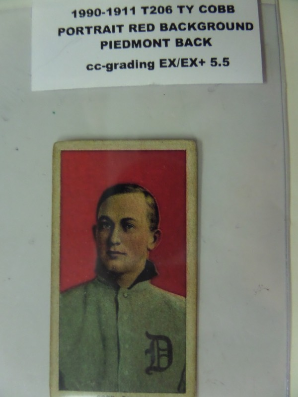 This Ty Cobb Baseball card is the T206 from 1909-1911 and is the PORTRAIT card with red background, and the PIEDMONT back. The card is  Nice looking card with slightly rounded corners and a few small marks on back. The centering is NICE both ways.  The card is graded by CC-GRading at EX/EX+ 5.5.  PSA online price guide says the card is worth $5250 in EX 5, but we will start lower as we always do.