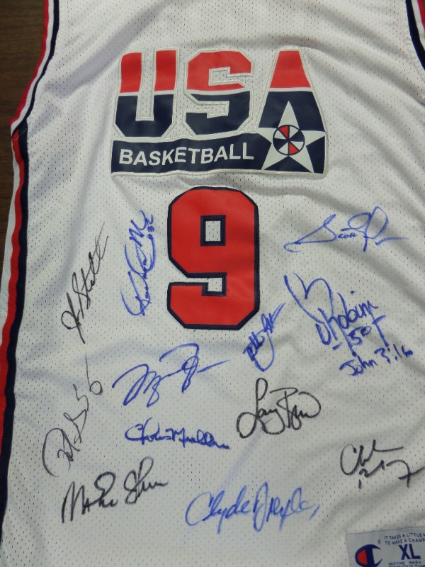 This mint home white is trimmd in Team USA blue and red team colors, and has sewn on everything as well as name on back. It is a cool piece, tagged right by Champion from 1992, and comes front side signed by everyone in bold black and blue sharpie. I see Jordan, Bird, Barkley, Drexler, Mullin, Magic, Malone and more, and grade is a clean bold 10 all over the place.