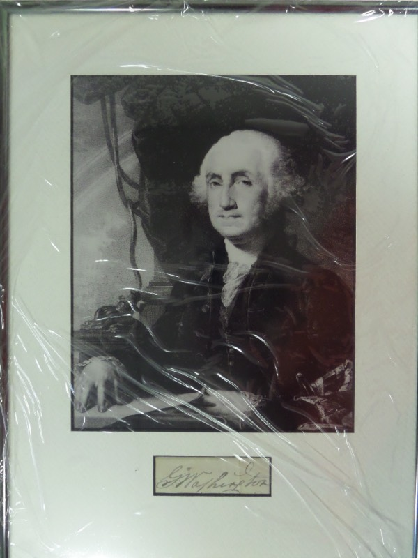 "This incredible find is a black ink signature from our 1st ever President, and measures nearly 5 inches long! It is the nicest Washington signature we have ever sold, comes custom matted and framed with a 1700's photograph, and value is mid-thousands, IF you can even find one. Solid buy and hold ""Great American"" investment and just look at our always low starting bid price."