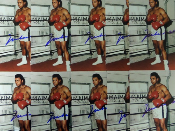 This amazing group opportunity is TEN full color 8x10 photos of Muhammad Ali, posing in a Miami gym in the mid 1970's.  Each is hand-signed in big, bold blue sharpie by the 3 time champ and HOF all time great himself, and since his death, each can easily retail into the mid hundreds by itself!  AWESOME CHANCE HERE!!!