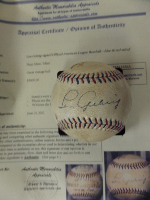This official Reach AL (Harridge) ball has red & blue stitching and is in VG shape overall. It comes sweet spot signed by this legendary Yankee HOFer in black ink and the autograph is NICE!  Comes with a professional COA/Appraisal from AMA (Authentic Memorabilia Appraisals) with a listed value of $5,000 on it. Wow!