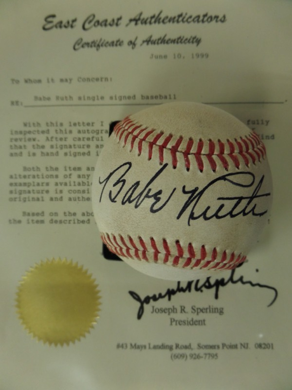 This red-laced, unlabeled vintage baseball is still in fantastic shape, and features the black fountain pen ink signature of Red Sox/Yankees all time great and Inaugural HOF Inductee, Babe Ruth!  Signature here is a beauty, grading a legible overall 9, and the ball includes a full LOA from East Coast Authenticators for certainty.  Retail here is 200 TIMES our anorexic minimum bid!