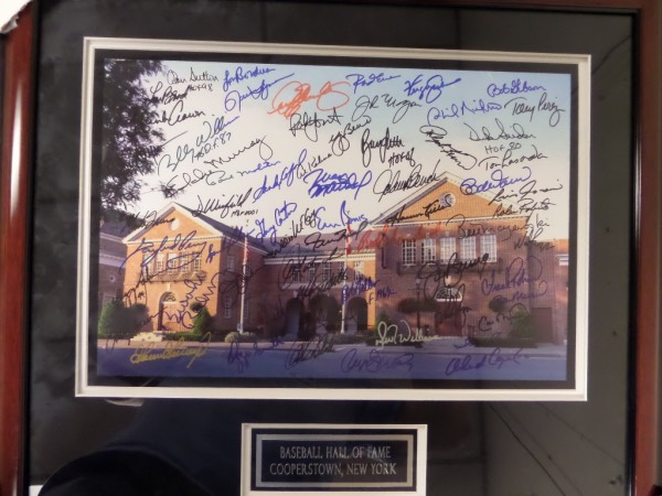 This amazing display and wall hanging is valued into the thousands and shows off well from 100 feet away! It is a huge 16x20 color HOF photo, comes sharpie signed by 61, and with some of the best names to ever play the game. It is professionally double matted and wood framed, belongs in every serious sports collection and features signers like Carew,Sutton,Aaron,Carter,Banks,Yaz,Gossage,Ozzie,Cal,Musial,Bunning,Maz,Duke,Bench,Koufax and many, many more. Wow...