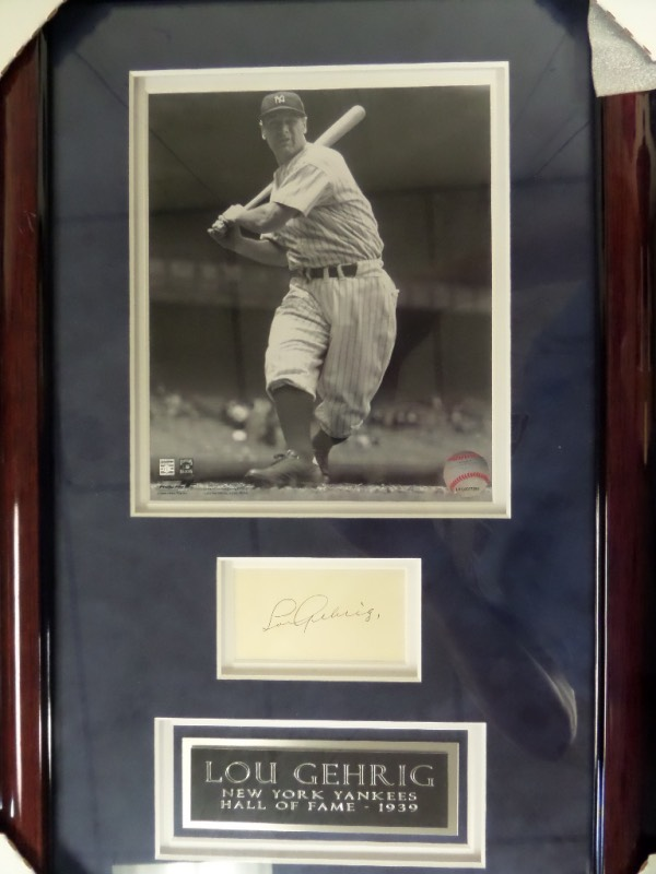 This custom double matted suede display is also wood framed, and about 13x22 in size. It holds a gorgeous B&W 8x10 of the late Yankee HOF great, as well as a legendary ink signature matted below,. That signature grades a legible 8, and value all over is 3 grand. Terrific look and chance, and held together by a Chris Morales forensics LOA.