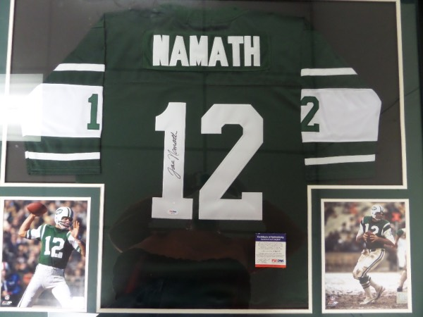 This enormous 34x42 custom framed and double matted display is done in Jets colors, and features two full color action 8x10's, and a green Namath #12 Jets jersey, MINT, with everything sewn, that comes hand-signed on the back number in black sharpie by Broadway Joe himself.  Signature is a strong, overall 8.5, and the piece is fully PSA/DNA certified (F34535) for authenticity purposes.  100% display-ready, and retail is low thousands!